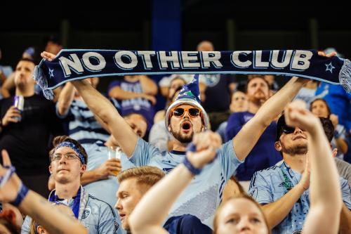 Man holding Sporting KC scarf