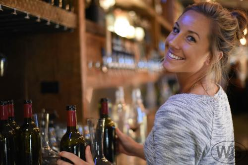 Woman serving wine at Carboy Winery