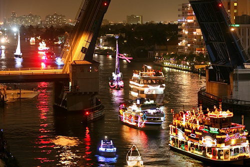 Ships sailing down the Fort Lauderdale waterway for the Winterfest Boat Parade