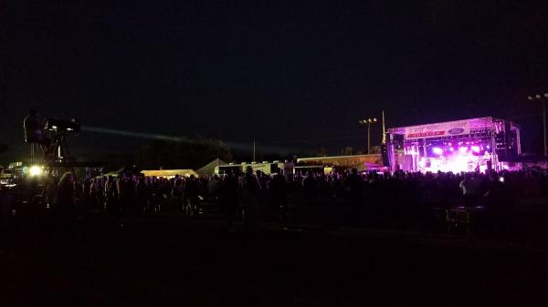 Outdoor country music concert at the Morgan County Fair Grandstand.