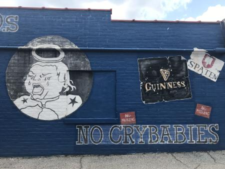 """The """"No crybabies"""" mural on the side of Five Points Bottle Shop."""
