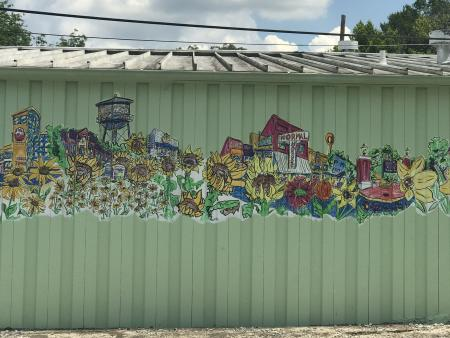 A mural of Athens with flowers on the side of Flowerland.