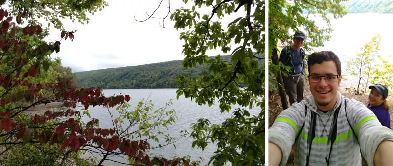 Hiking group takes a selfie on the wooded shoreline of Hemlock Lake in New York's Finger Lakes.