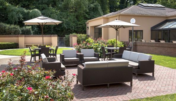 Landscaped outdoor patio lounge, open seasonally