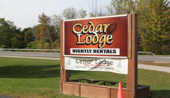 Sign by the road at the Cedar Lodge