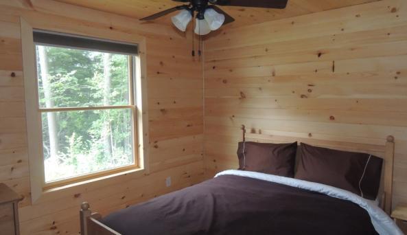 Queen size bedroom with armoire & dresser