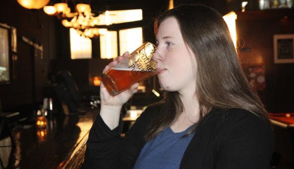 enjoying a glass of beer at Scotland Yard Pub