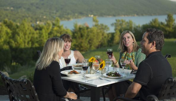 Guests Dining on Outdoor Patio at Bristol Harbour