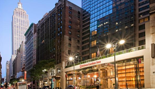 exterior at night of Hilton Garden Inn New York/Midtown Park Avenue
