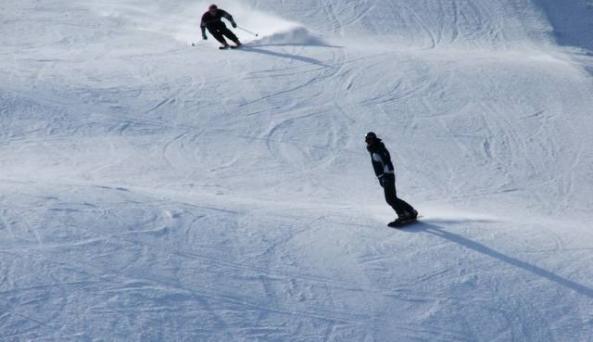Catamount Ski Area snowboarder and skier.jpg