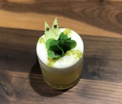 VASO Celtic Cocktail with a frothy top and green mint leaves.
