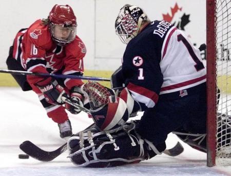 Sara DeCosta defends hockey goal