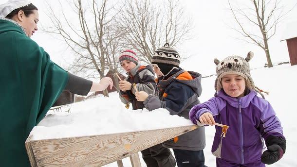 Kids tasting maple syrup