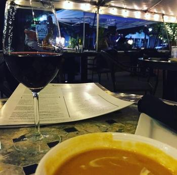 Tucci's Patio table with glass of wine