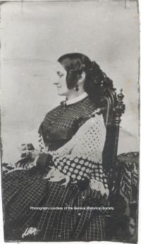 Writer Sarah Bradford is pictured sitting in a chair