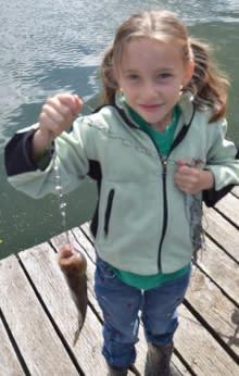 Fishing off Mercer Lake Resort Dock by Taj Morgan