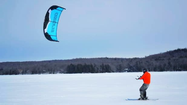 Man Kitesurfing on Snow