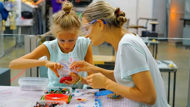 People making crafts at Corning Museum of Glass