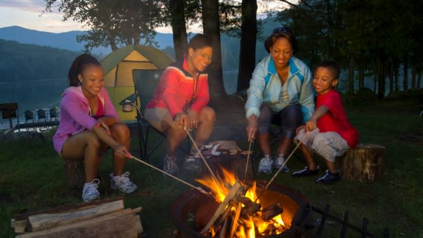 Family roasting marshmallows at campgrounds at Allegany State Park