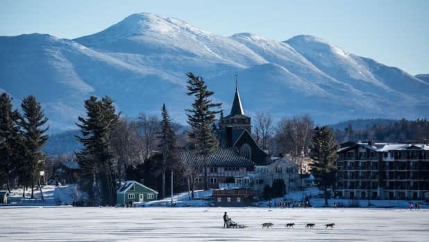 Dog Sledding Over Mirror Lake