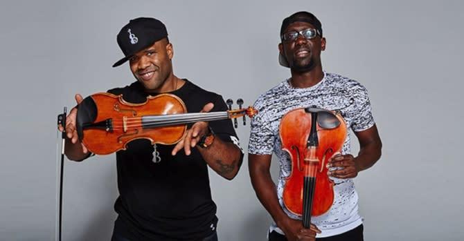 black violin band poses for photo