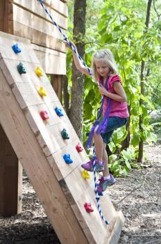Climbing the outdoor wall at Kansas Children's Discovery Center