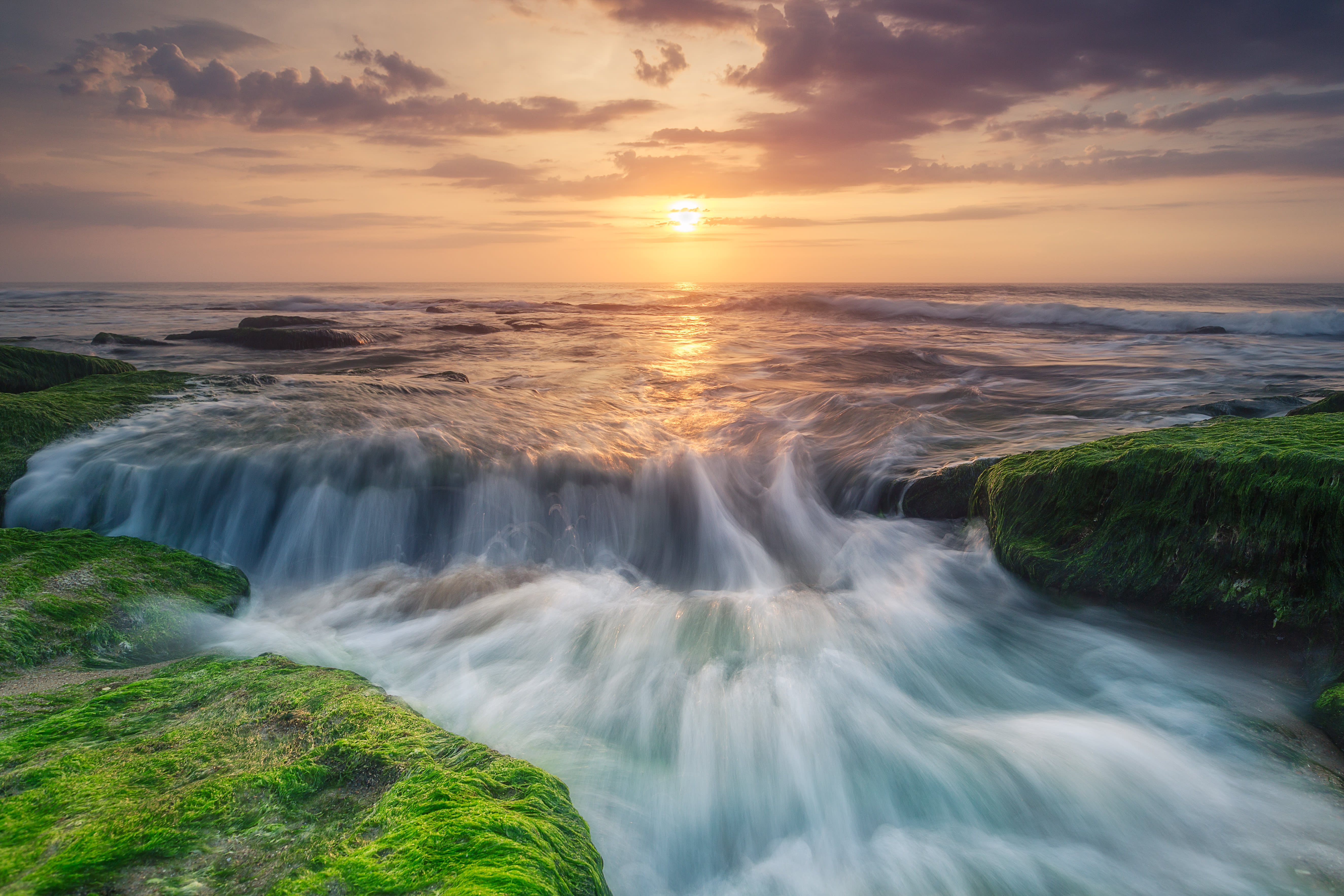 Water Flowing Over Coquina Rocks at Sunset