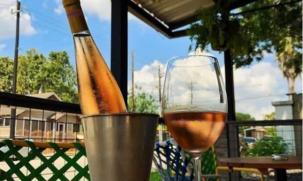 Wine bottle at Better Luck Tomorrow restaurant patio in Houston