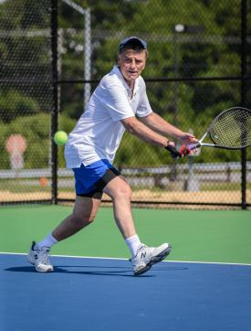 Man playing tennis in Howard County, MD
