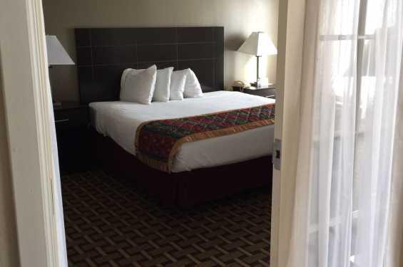 Two Room King Suite Bedroom w/ door