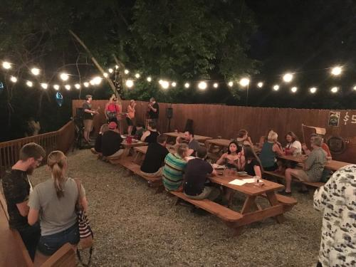 Floyd Co. Brewing Biergarten at night with people