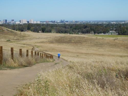 Runner on a trail at Quail Hill Loop near Irvine, CA