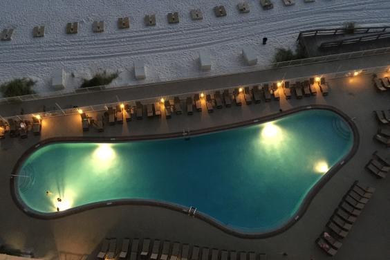 Treasure Island pool at night from balcony