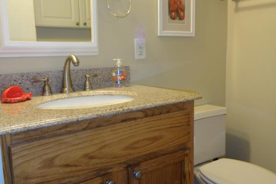 Upgraded bath with granite counter, oak vanitiy
