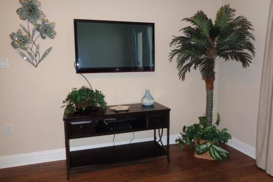 Family room with new flat screen tv and wood flooring