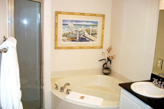 Master Bath with double vanity, soaking spa tub and separate tiled shower.