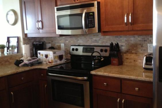 Kitchen with custom cabinets and granite countertops