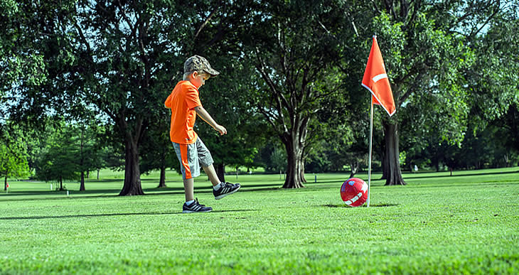 Boy playing Foot Golf