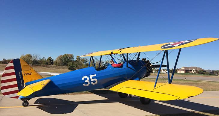 Man in a retro biplane at Stearman Field