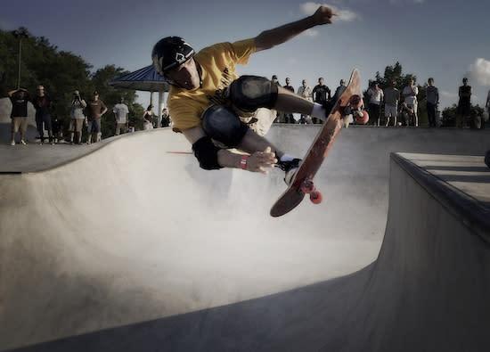 Skateboarder doing tricks at skate park in Houston