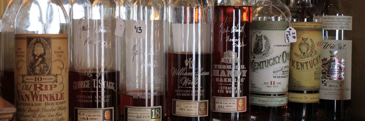 A row of bourbon bottles at Tousey House, including Rip Van Winkle