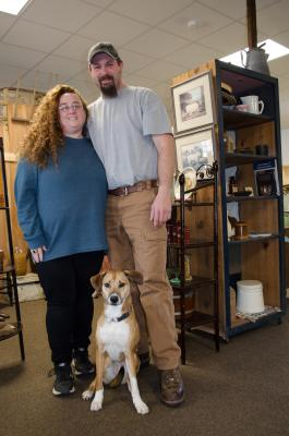 Owners Denise and Josh (with Jake) stand in the newly reopened Barn Fresh Vintage Market.