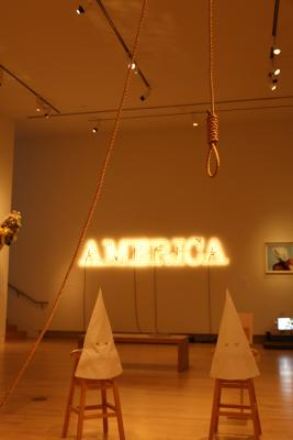 Duck, Duck, Noose by Gary Simmons and America by Glenn Ligon meld together in 30 Americans, on display at the Tacoma Art Museum in Tacoma, Washington