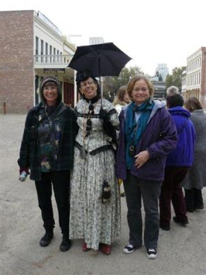 Carol and Janet pose for a photo with Miss Odette in Old Sacramento, their guide for the Undergound Tour. Tours will start again on March 31.