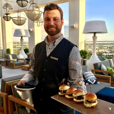 A server with burgers at Hive and Honey
