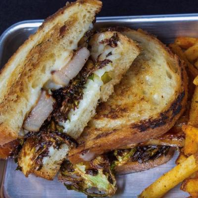 Pork Belly Melt served with fries at Devilicious Eatery in Temecula, Southern California