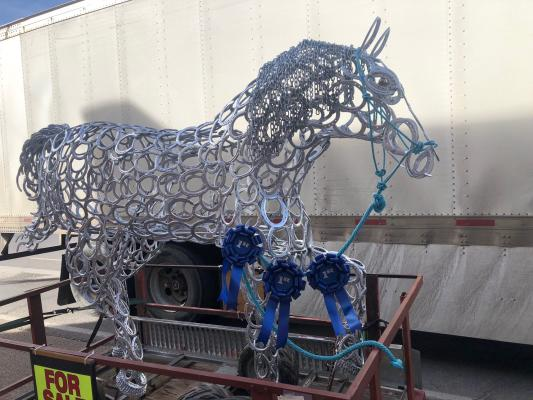 Horse made from horse shoes