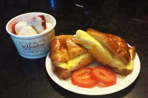 La Madeline's breakfast on a croissant with strawberries Romanoff