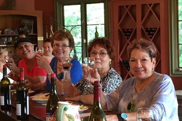 Women enjoying a glass of wine at JCP Wine Tasting in Louisisana