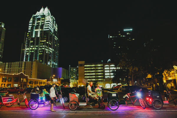 Pedi Cabsin downtown Austin at night